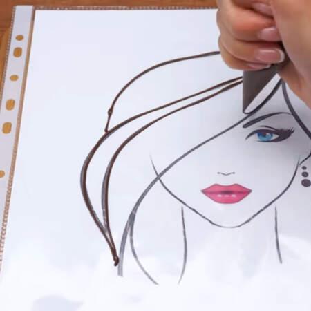 Распечатанную векторную картинку с рисунком девушки кладем в файл и обводим все контуры рисунка растопленным шоколадом или шоколадной глазурью.