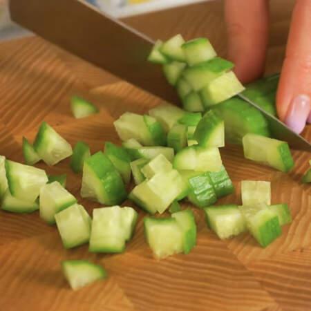 Огурец также нарезаем мелкими кубиками.