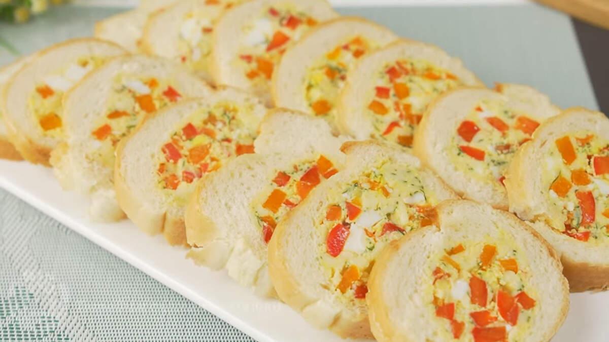 Бутерброды по другому получились красивыми и вкусными. Готовятся просто и из доступных продуктов. Начинку можно изменять по своему вкусу, например добавить грибы, помидоры, колбасу или мясо.